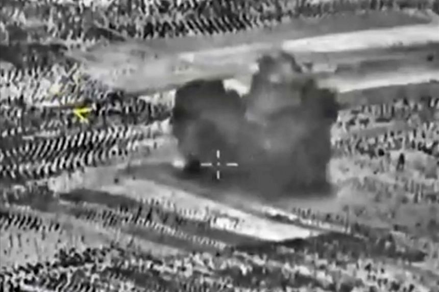 A handout frame grab taken from a video footage made available on the official website of the Russian Defence Ministry on Oct 2, 2015, claims to show a strike carried out by Russian warplanes near Maarrat Al-Nuuman, Idlib province, Syria, on Oct 2, 2