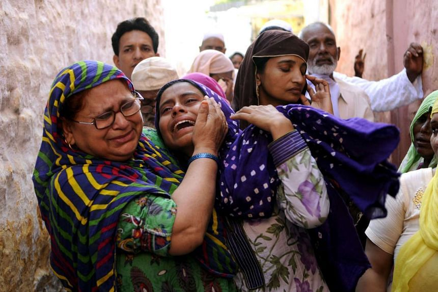 Relatives of Mohammad Akhlaq mourn after he was killed by a mob on 28 Sept over suspicions he had eaten beef.