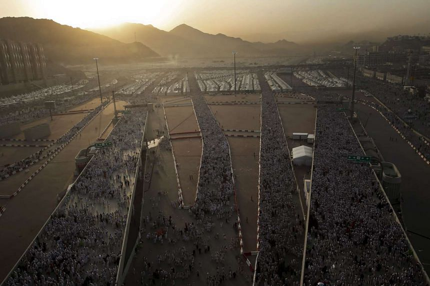Muslim pilgrims walk on roads as they head to cast stones at pillars symbolizing Satan during the annual haj pilgrimage in Mina on the first day of Eid al-Adha, near the holy city of Mecca on Sept 24, 2015.