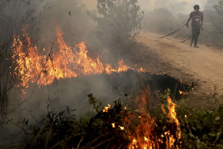 An Indonesian soldier fighting a peatland fire in Ogan Ilir, Sumatra on Sept 30, 2015.