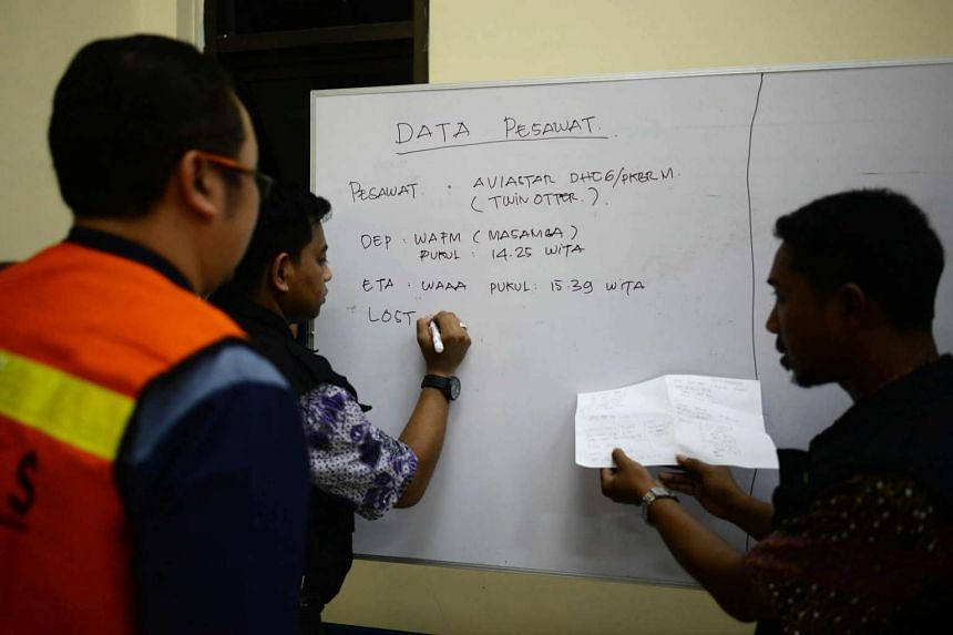 An airport Officer writes the details of the missing Aviastar plane at a crisis center in Hasanuddin International Airport in South Sulawesi, Indonesia on Oct 02, 2015.