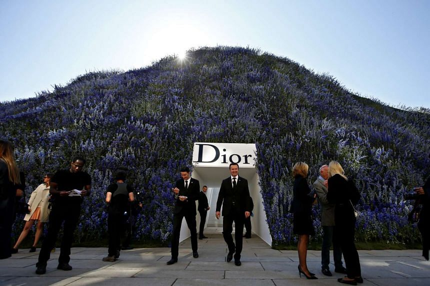 Guests wait in the Cour Carree of the Louvre Museum before the presentation of the Spring/Summer 2016 Ready to Wear collection by Belgian designer Raf Simons for Dior fashion house during the Paris Fashion Week, in Paris, France, on Oct 2, 2015.