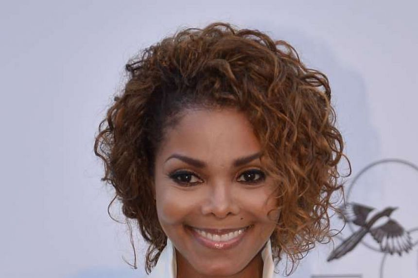 This May 23, 2013 file photo shows US singer Janet Jackson as she arrives for the amfAR's 20th Annual Cinema Against AIDS during the 66th Annual Cannes Film Festival in Cap d'Antibes, southern France.