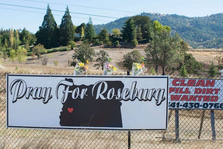 A sign at the entrance to Umpqua College calls for prayers in Roseburg, Oregon, Oct 2, 2015.