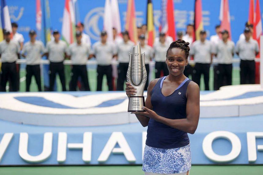Venus Williams won the Wuhan Open in central China on Saturday, after Garbine Muguruza retired in the second set.