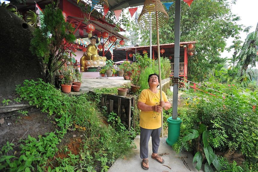 Ubin resident Ong Siew Fong, 72, who is one of the founders of the Wei To Temple, at the site. A Hindu shrine was recently established there alongside a Tibetan Buddhist temple and Taoist one.