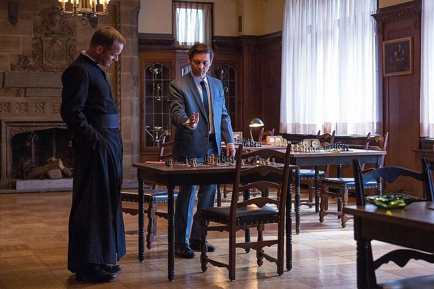 Tobey Maguire (left) as Bobby Fischer, with Peter Sarsgaard (far left) as William Lombardy, a priest and chess grandmaster, in Pawn Sacrifice.