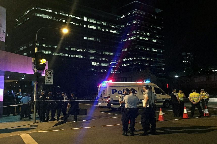 Police securing the area after the shooting incident that left two dead in Parramatta, a suburb in the metropolitan area of Sydney yesterday.