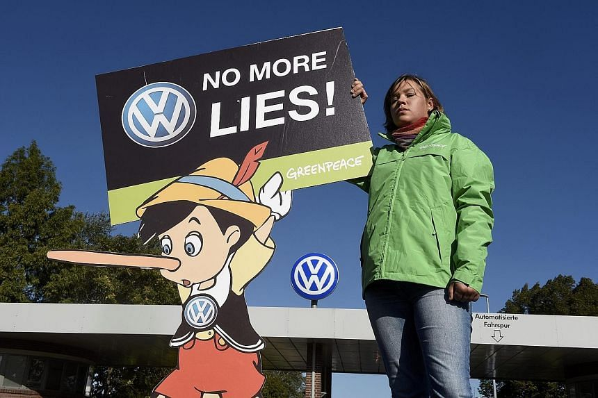 A Greenpeace activist protesting in front of Volkswagen's factory in Wolfsburg, Germany, last month over the carmaker's emissions scandal.