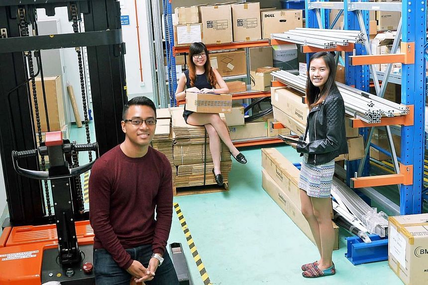 (From left) Mr Muhammad Nazmi Mohamed Zaaini, 23, Ms Tan Li Qi and Ms Brenda Cheng Bifeng, both 21, are part of the first batch of polytechnic graduates in the SkillsFuture Earn and Learn scheme. They started classes at Republic Poly yesterday. The 1
