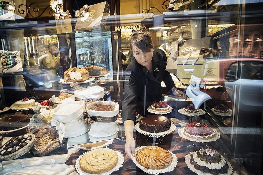 Pastries in a window facing the street at Cova Caffe, owned by LVMH Moet Hennessy Louis Vuitton, in Milan, Italy.