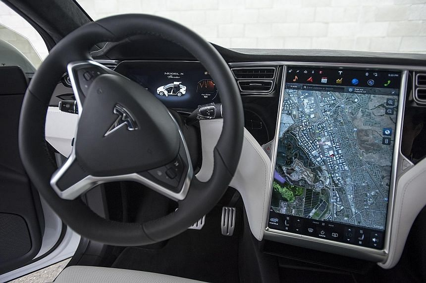 Tesla will be one of the first carmakers to deliver over-the-air updates.