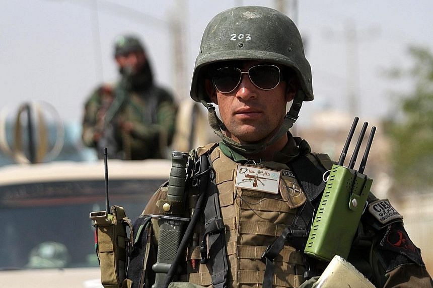 The Taleban's success in Kunduz marked a blow for Afghanistan's Nato-trained forces (left), who have largely been fighting on their own since December.