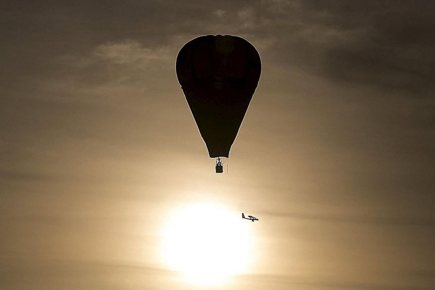 A hot air balloon in flight. If temperatures exceed the 2 deg C target, scientists say, the effects of climate change will become more intense.