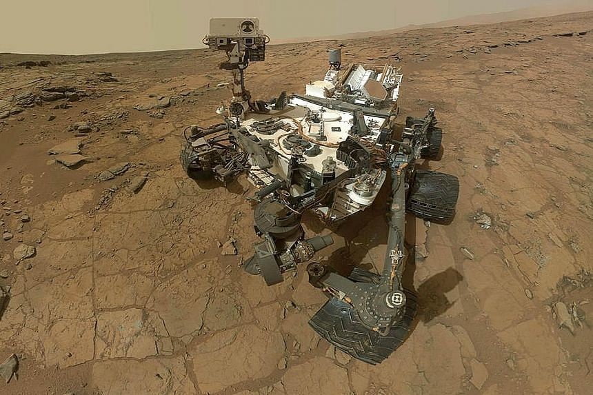 "A self-portrait of Nasa's Mars rover Curiosity, a multi-billion-dollar robot dispatched to search for life. There are risks that microbes from Earth on the machine may harm whatever life is on Mars or that ""signs of life"" discovered may turn out to b"