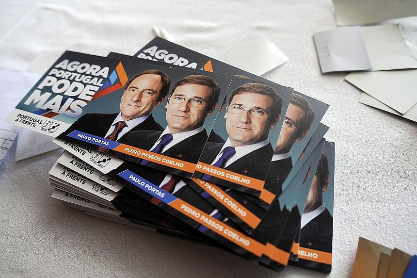 Campaign fliers for Portuguese Prime Minister Passos Coelho's ruling coalition. Tomorrow's elections are likely to go down to the wire.
