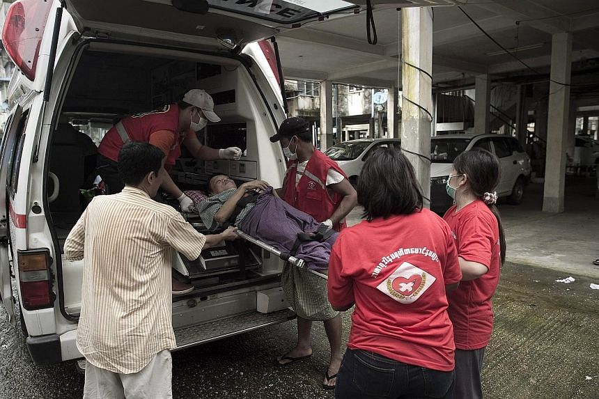 Volunteers from Noble Heart, a local NGO providing free ambulance services, transporting a patient from a hospital to his home in Yangon.