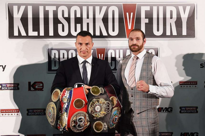 Wladimir Klitschko (left) and British challenger Tyson Fury (right) at a press conference in London.