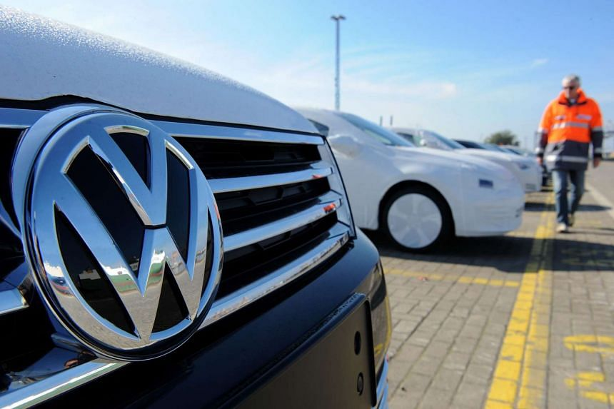 A new Volkswagen (VW) car is seen in the foreground as new cars of the Volkswagen group are parked ready for shipping at the car terminal of the port of Bremerhaven, northwestern Germany, on Oct 2, 2015.