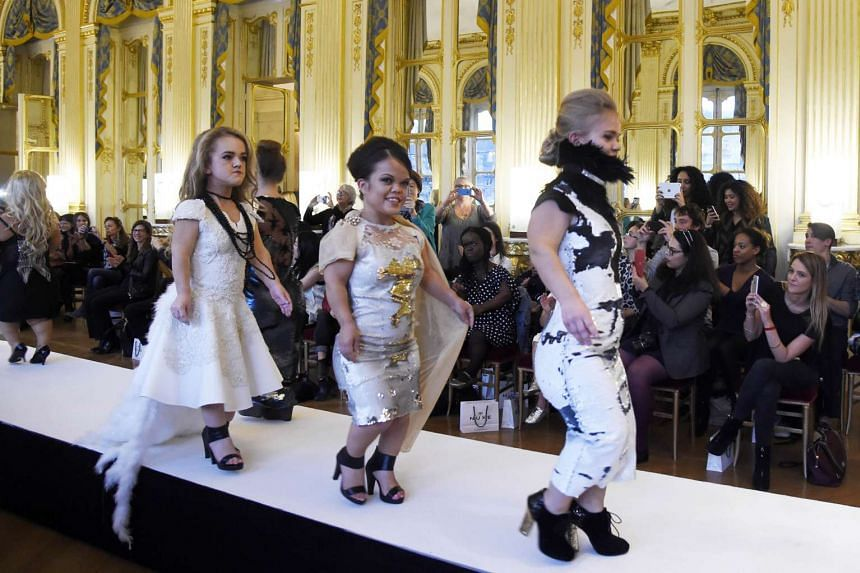 """Models present creations during the """"Dwarf Fashion Show"""" in Paris."""