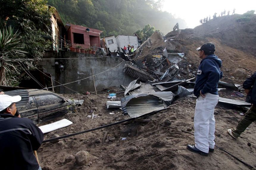Heavy rains unleashed a torrent of boulders and mud over some 70 homes Thursday night in Santa Catarina Pinula.