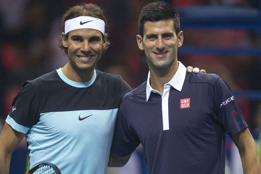 Rafael Nadal  (left) and Novak Djokovic pose for photographs before their friendly tennis match in Bangkok.
