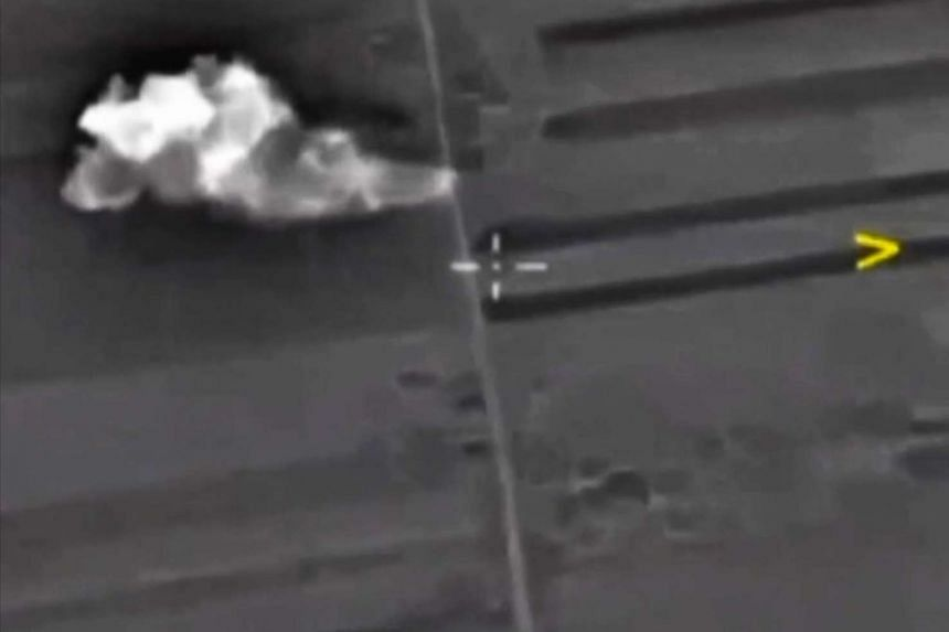 A handout frame grab taken from video footage released by the Russian Defence Ministry's press service 02 October 2015 shows an airstrike carried out by Russian warplanes