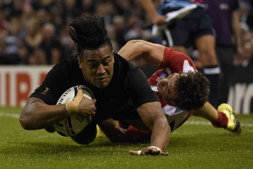 New Zealand's wing Julian Savea scores his third and his team's sixth try.
