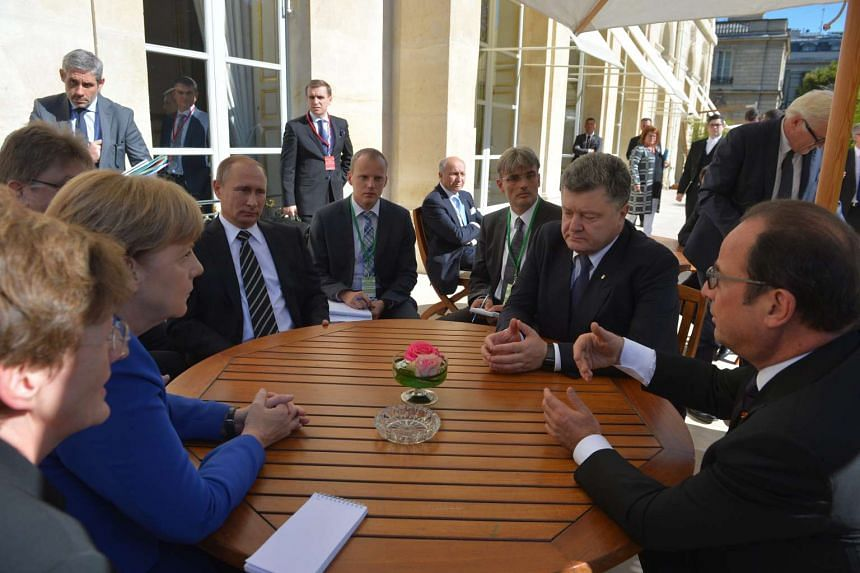 Leaders attend a meeting on Ukrainian crisis at the Elysee Palace in Paris, France, Oct 2, 2015.