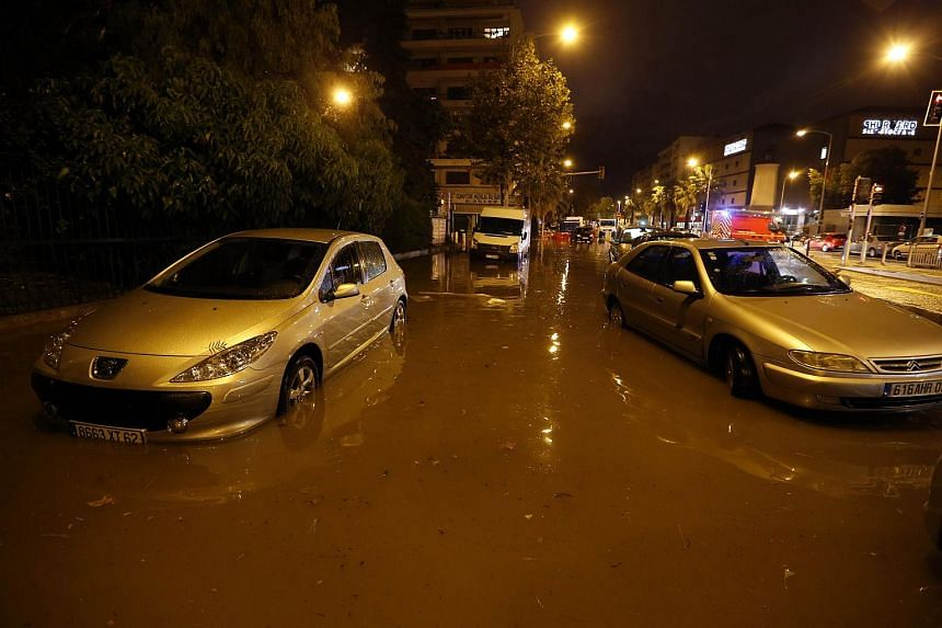 Cars on a flooded street in Nice on Oct 3, 2015.