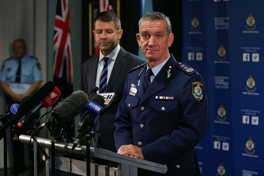New South Wales Police Commissioner Andrew Scipione (right) and Premier Mike Baird at a press conference in Sydney, Australia, on Oct 3, 2015, on the fatal shooting of a police employee leaving Sydney police headquarters on Oct 2 by a 15-year-old boy