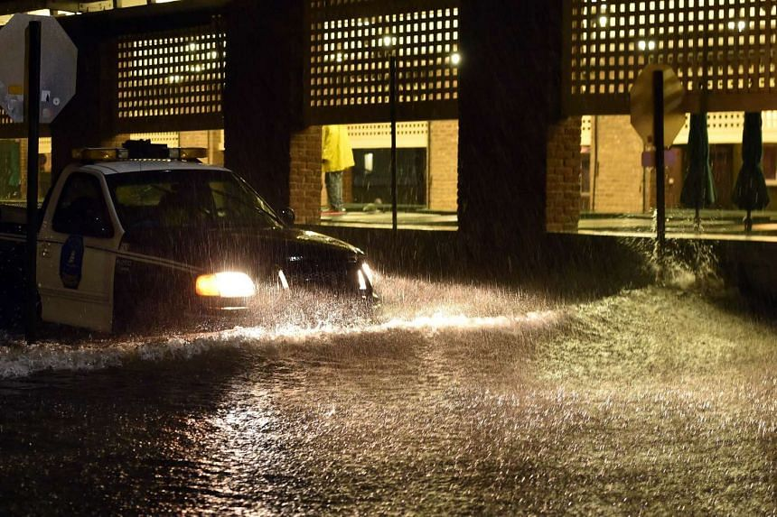 A police car makes its way on a flooded street in downtown Charleston, South Carolina, on Oct 3, 2015.