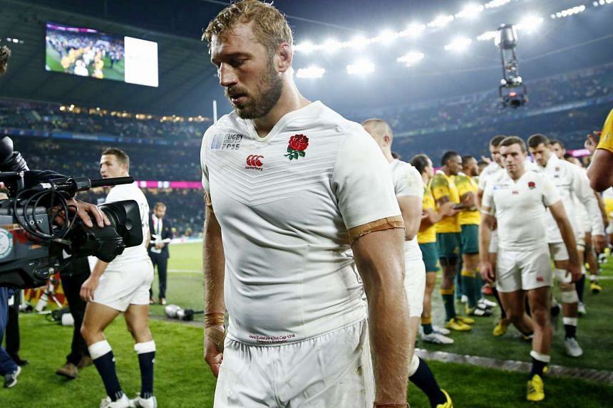 England captain Chris Robshaw walks dejectedly off the field after the loss to Australia on Oct 3, 2015, that saw the host nation dumped out of the Rugby World Cup.