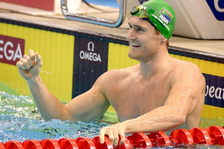 South Africa's Cameron van der Burgh celebrating after winning the men's 100m breaststroke at the OCBC Aquatic Centre on Oct 4, 2015.