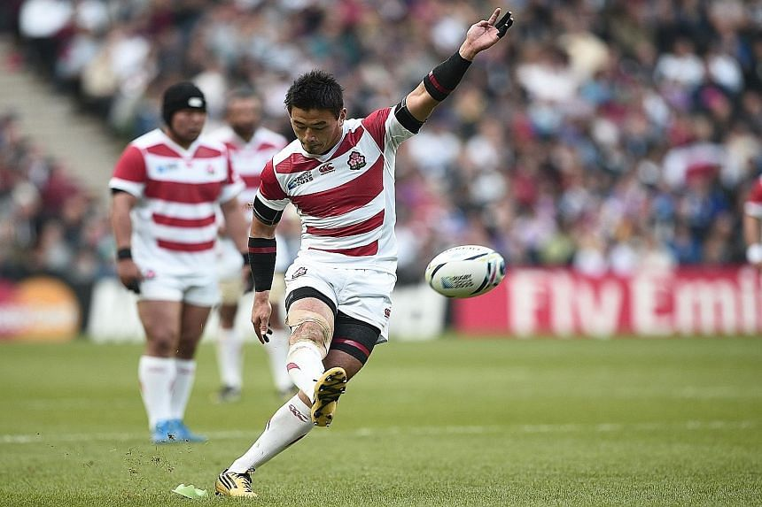 Japan's full-back Ayumu Goromaru kicking a penalty during their Pool B tie against Samoa at the Rugby World Cup in Milton Keynes, north of London yesterday. He scored 16 points to add to two tries as Japan won 26-5 to earn their second win and keep a