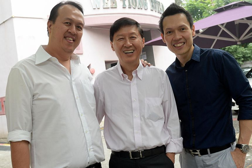 Wee Tiong Holdings founder Tan Siong Kern (centre), with his sons Wee Tiong (left), the firm's finance director, and Wee Beng, its chief executive. Mr Tan Wee Beng had initially planned to pursue an engineering career, but acceded to his father's req