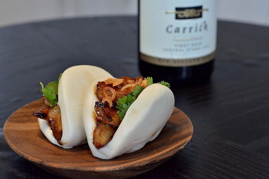 Chef Malcolm Lee's Caramelised Pork Cheek Bun With Lemongrass Blue Ginger Soy Reduction.