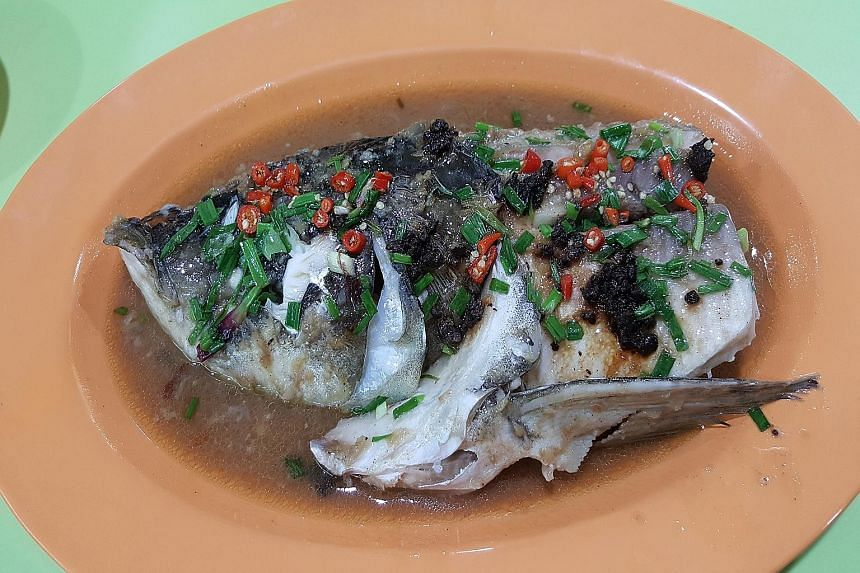 For two people, pair the steamed fish head in bean sauce (above) with a small plate of sambal tapioca leaves.