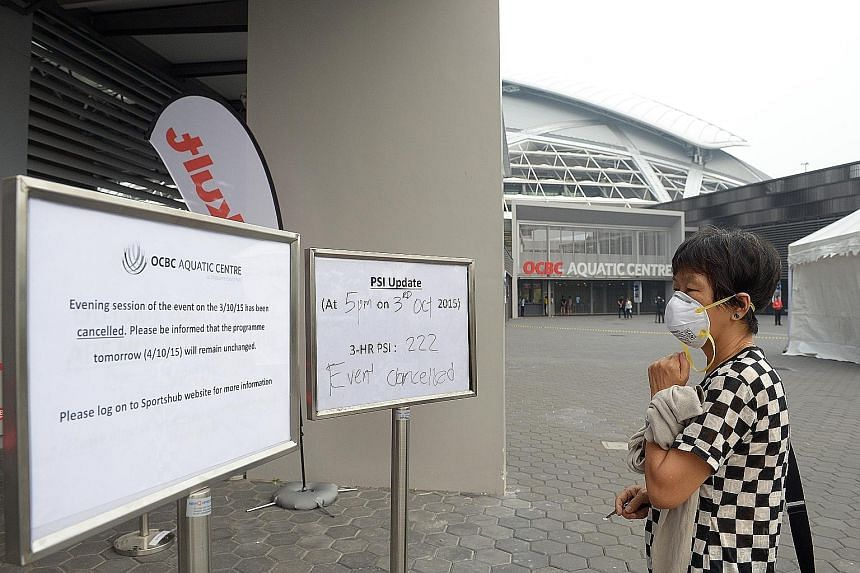 A disappointed fan looking at the signages of haze updates and the cancellation of the World Cup Day 1 finals at the OCBC Aquatic Centre. The organisers are hoping for better conditions today.