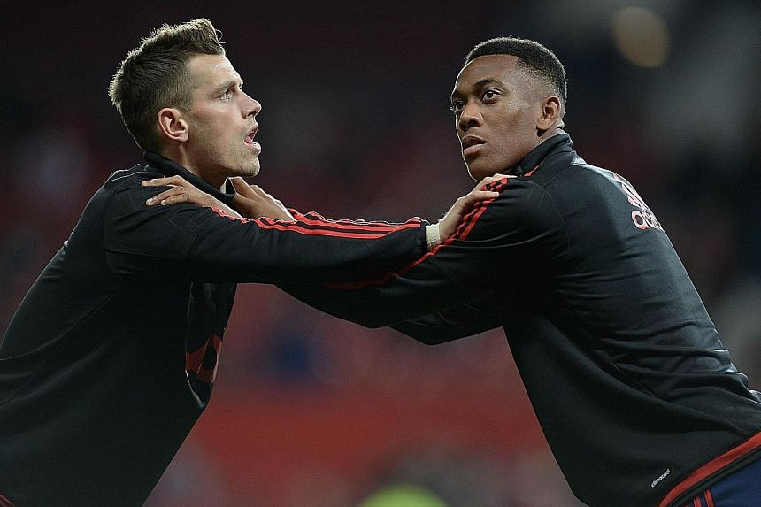 Manchester United's French teenage star Anthony Martial (right) warming up with team-mate and countryman Morgan Schneiderlin. While former United winger Lee Sharpe is not enthralled with Louis van Gaal's tactics, he feels the 19-year-old Martial is a