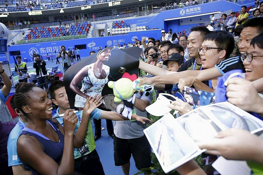 US veteran Venus Williams obliging fans after beating Garbine Muguruza when the Spaniard retired in the Wuhan Open final. Both players have reason to smile as they will enter the top eight spots in the WTA Finals Road to Singapore leaderboard.