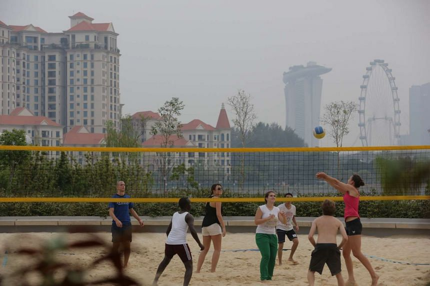 Volleyball enthusiasts playing a game at the Singapore Sports Hub at 5.00pm on Sunday, Oct 4, 2015.