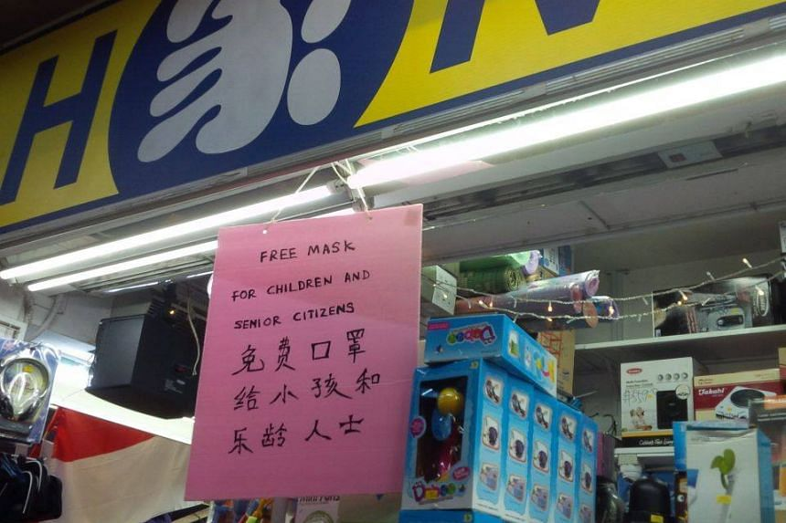 Hardware shop Home in Clementi put up a sign announcing that it was giving away free masks to the elderly and children.
