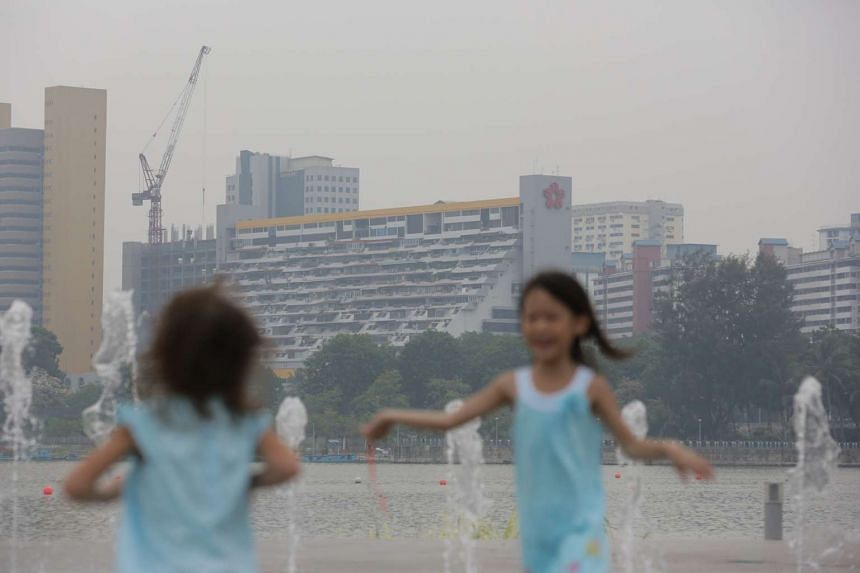 Two girls playing at the Singapore Sports Hub amid improved haze conditions at around 5pm on Oct 4, 2015.