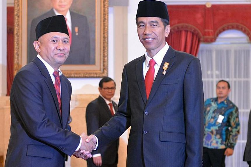 Indonesia's recently appointed Chief of Presidential Staff Teten Masduki (left) with President Joko Widodo. Mr Teten, who has been given the task of coordinating efforts to deal with the haze, says the problem is more pressing this time due to the im