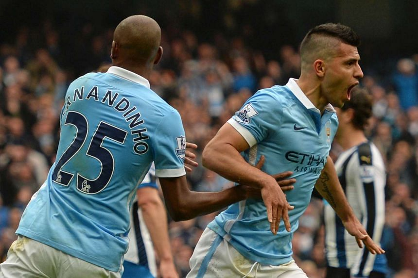 Aguero (right) reacts after scoring Manchester City's first goal.