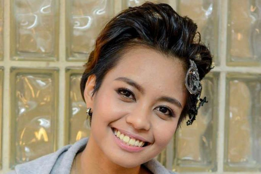 Indonesian singer Xie Weina, adopted by an Indonesian- Chinese woman, is unsure of her race.