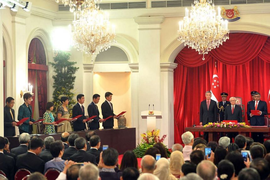 President Tony Tan Keng Yam and Prime Minister Lee Hsien Loong with (from left) Dr Maliki Osman, Mrs Josephine Teo, Dr Amy Khor, Ms Indranee Rajah, Mr Heng Chee How, Mr Ong Ye Kung and Mr Ng Chee Meng as they took their oaths, led by Chief Justice S