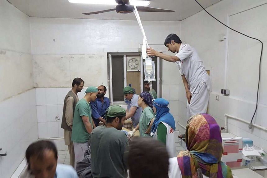 Afghan MSF surgeons work inside the Medecins Sans Frontieres hospital after a suspected US air strike.