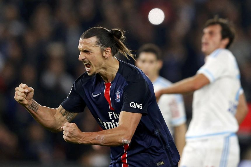 PSG striker Zlatan Ibrahimovic celebrating one of two penalties he scored against Marseille, which made him the club's leading goalscorer in history with 110 goals.